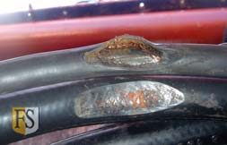 Electrical cables damaged by mechanical wear under rough conditions.