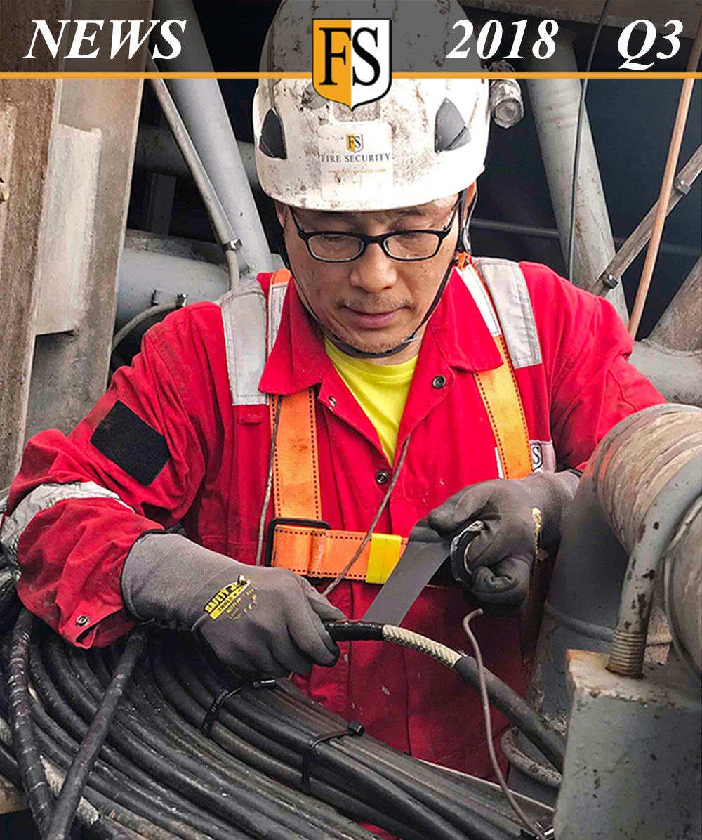 Fire Security Newsletter frontpage 2018-Q3_Steven Chong doing Cable repair